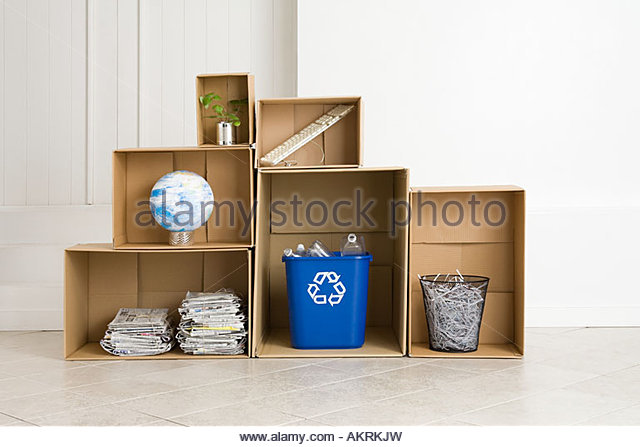A recycling bin and various objects - Stock Image