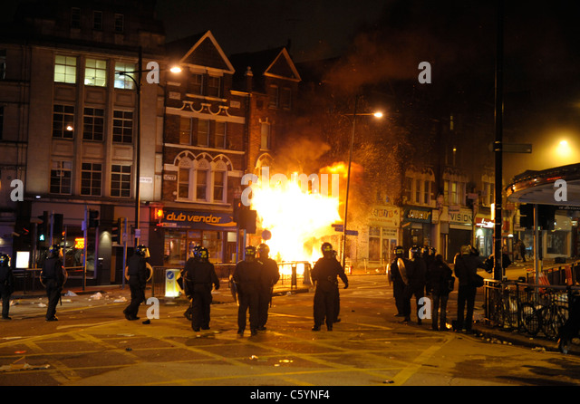 Riot Police at Clapham Junction after Party Superstore set alight by rioters during a night of rioting at Clapham - Stock Image