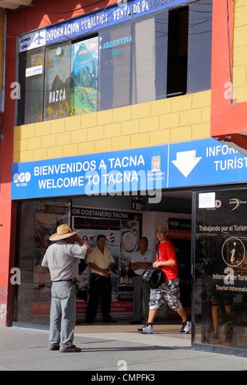 Peru Tacna Panamericana Pan American Highway bus terminal exterior ground transportation coordinator Hispanic man - Stock Image