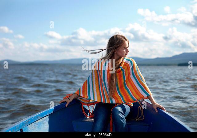 Caucasian teenage girl in canoe on lake - Stock Image