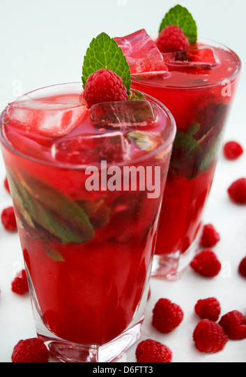 Berry Delicious Cocktail- Bright red long drink with recipe - Stock Image
