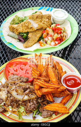 Everglades Florida City Camellia Street Grill plates dinner fish seafood meat - Stock Image
