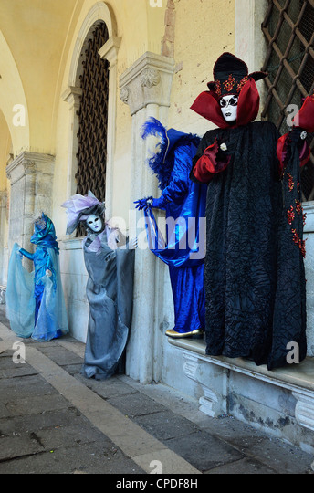 Masked figures in costume at the 2012 Carnival, Venice, Veneto, Italy, Europe - Stock Image