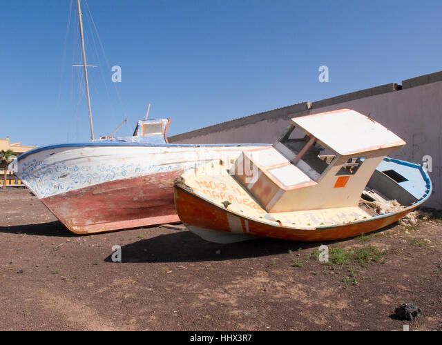 Two beached boats at Corralejo,  Fuerteventura, Canary Islands. - Stock Image