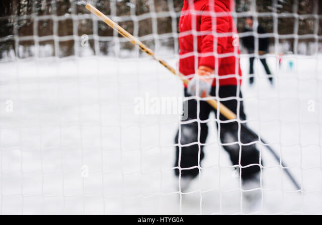 Boy standing in ice hockey goal - Stock Image