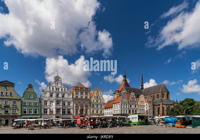 new market, street market,   St Marys church , Marienkirche, Rostock , Mecklenburg-Vorpommern, East Germany - Stock Image