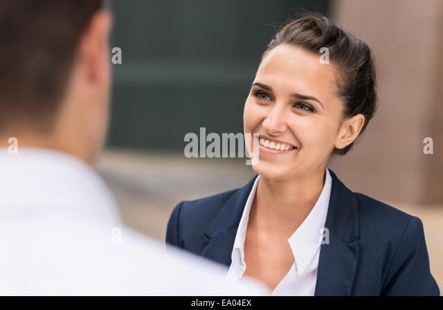 businesswoman and man chatting, London, UK - Stock Image