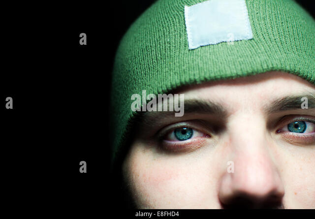 Close-up portrait of a man wearing a beanie hat - Stock Image