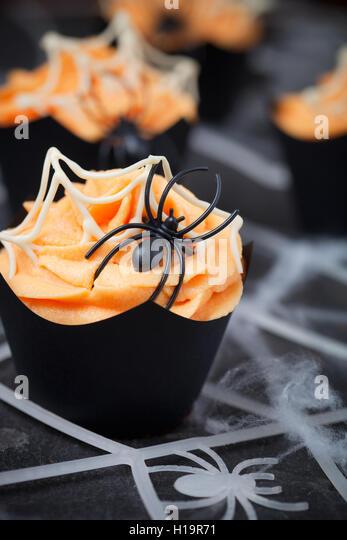 Orange spider cupcake for Halloween - Stock Image