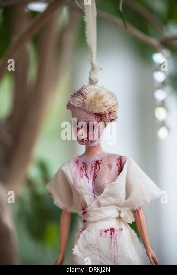 Hanged blood-smeared Barbie doll - Stock Image