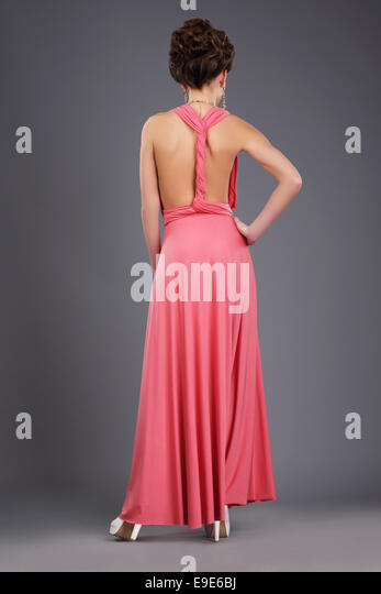 Rear View of Shapely Lady in Evening Gown - Stock Image