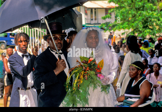 Bride and groom in formal wedding attire in the Old Time Wedding at Moriah Village in Tobago Hertige Festival cultural - Stock Image
