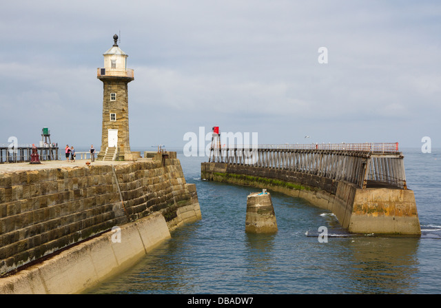 Whitby East Pier extension and lighthouse separated from the inner stone pier after the bridge was damaged by storms - Stock Image
