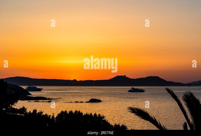 Fabulous orange sunset over Sardinia, Italy - Stock Image