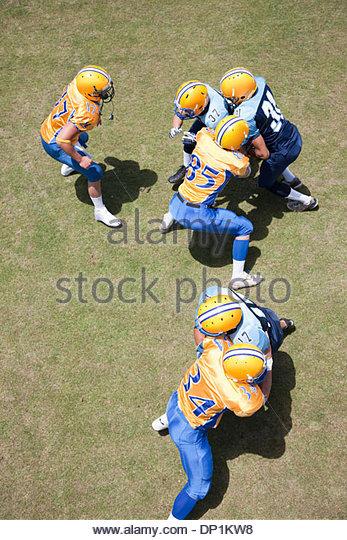 Football players playing football - Stock Image