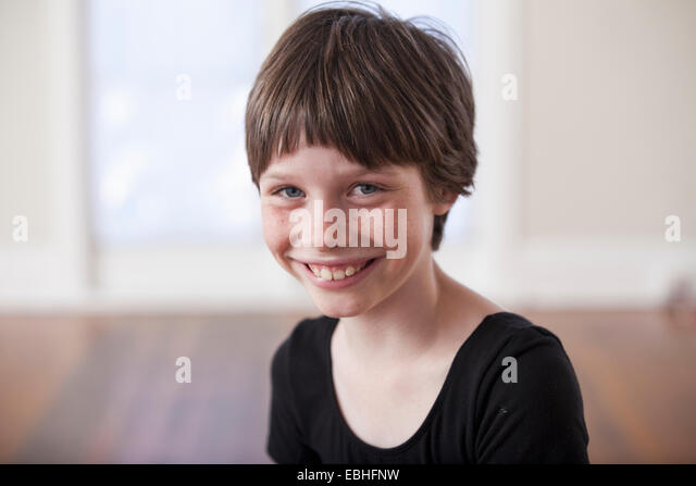 Portrait of smiling girl in ballet school - Stock Image