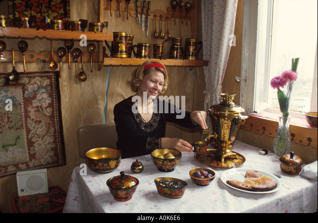 Russia former Soviet Union Moscow resident dining area in home using samovar - Stock Image