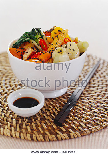 Fried tofu with vegetables and black sesame - Stock Image