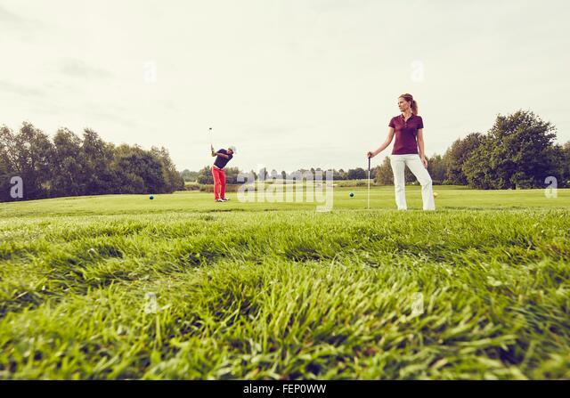 Golfers playing golf on course, Korschenbroich, Dusseldorf, Germany - Stock Image