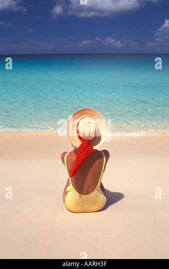 woman in yellow bathing suit on beach MR 1 - Stock Image