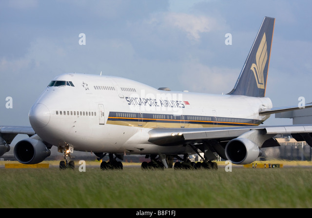 Singapore Airlines Boeing 747-412 taxiing for departure at London Heathrow airport. - Stock Image