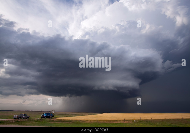 A Doppler on Wheels mobile radar truck scans a storm near Dodge City, Kansas. The DOW truck is participating in - Stock Image
