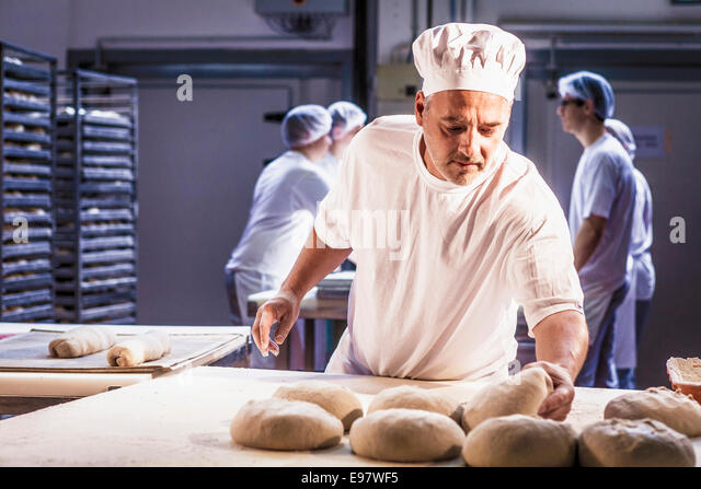 Baking bread, chef controlling dough - Stock Image