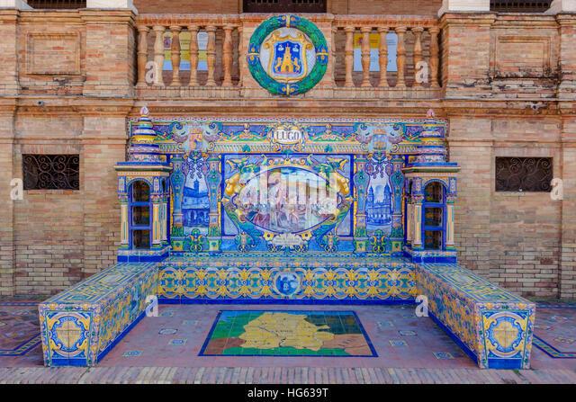 Glazed tiles bench of spanish province of Lugo at Plaza de Espana, Seville, Spain - Stock Image