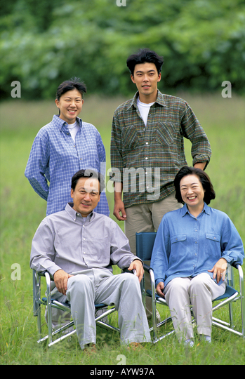 Young couple with their parents - Stock-Bilder