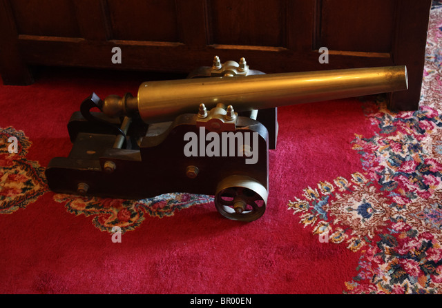 old retro vintage toy cannon red carpet - Stock Image