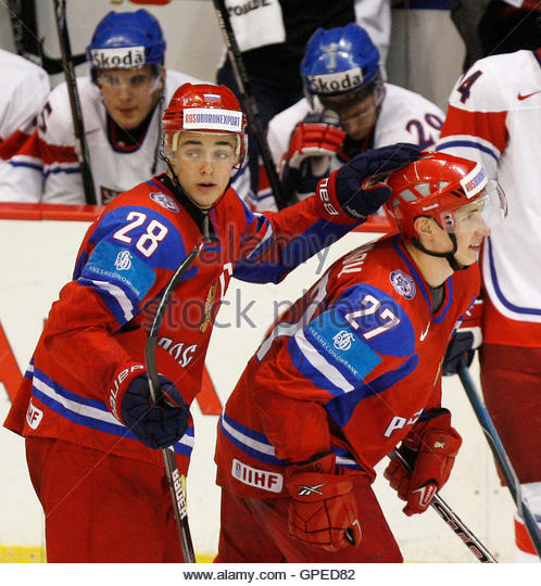 Russia's Maxim Chudinov is congratulated by his teammate Nikita Filatov (L) after he scored a goal against Czech - Stock Image
