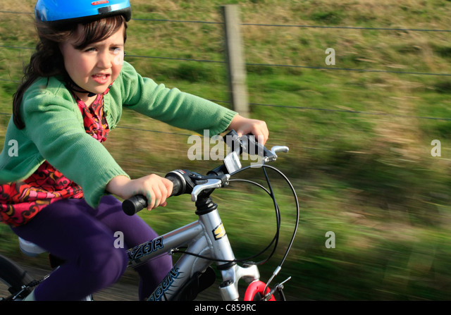 Child enjoying the fresh air on a bike - Stock Image