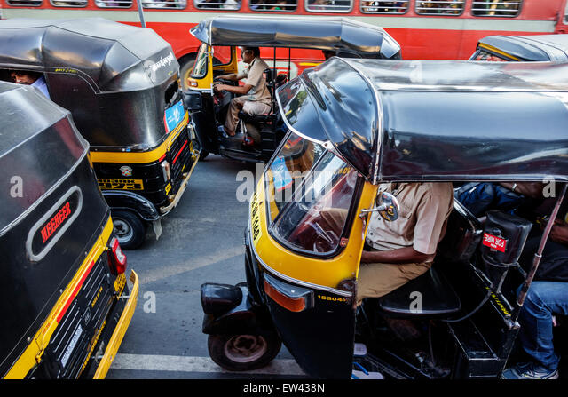 India Indian Asian Mumbai Andheri East Mathuradas Vasanji Road auto rickshaw three-wheeler trishaw autorick bajaj - Stock Image