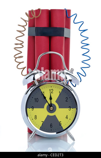 Time bomb, alarm clock attached to dynamite sticks, symbolic image, nuclear energy - Stock Image