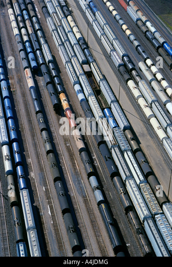 Tank cars and hopper cars mostly for transporting chemicals standing by in a Southern Illinois yard awaiting makeup - Stock Image