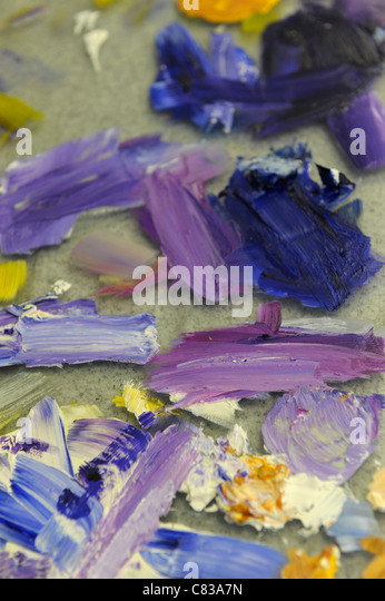 Paintbrush daubs. Blue, orange and yellow - Stock Image
