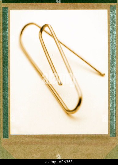 close up of paperclip, paper clip, polaroid transfer - Stock Image