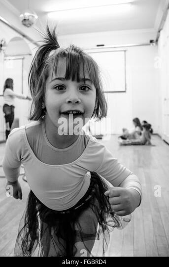 Portrait Of Cute Girl Making Face At Studio - Stock Image