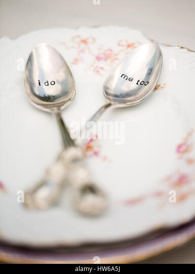 Bride and groom's teaspoons ('I do' 'me too') - Stock Image