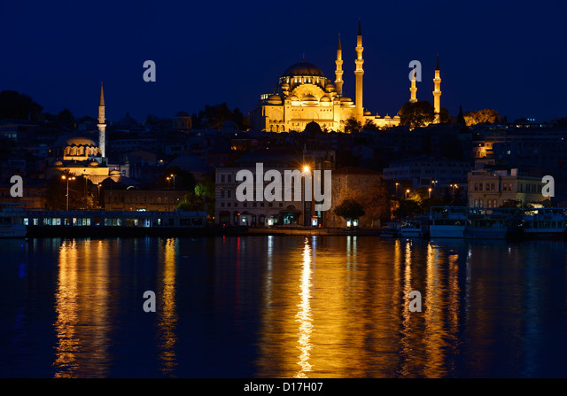 Rustem Pasha and Suleymaniye Mosques in Istanbul reflected before dawn in waters of the Golden Horn Turkey - Stock Image