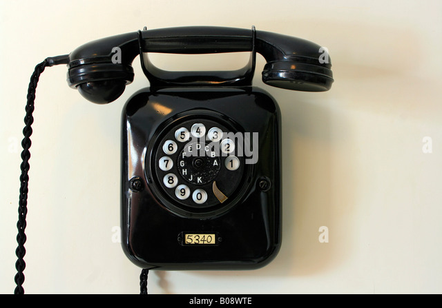 Old-fashioned rotary dial telephone - Stock Image