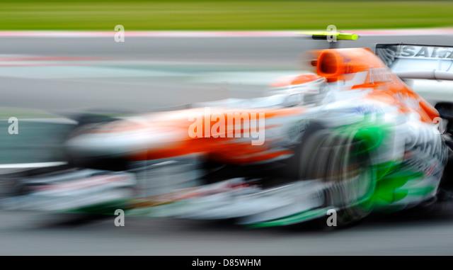 blurred Force India Formula One race car  during the Spanish Formula One Grand Prix race 2013 - Stock-Bilder