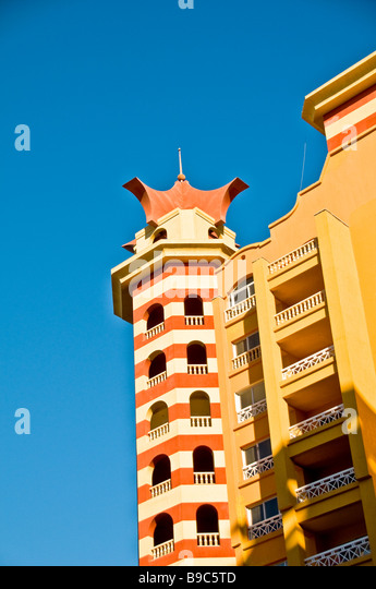 Porto Marina Resort and Spa fantasy hotel building architecture bright colors red Egypt Mediterranean North Coast - Stock Image
