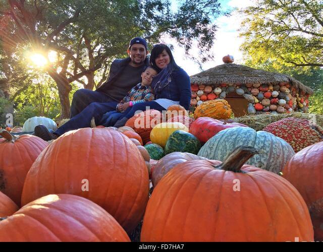 Portrait Of Smiling Family With Pumpkins At Village - Stock-Bilder