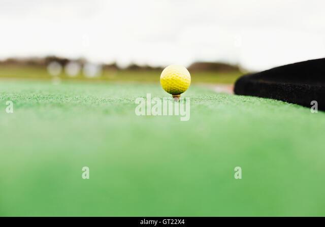 Close-up of golf ball on tee - Stock-Bilder
