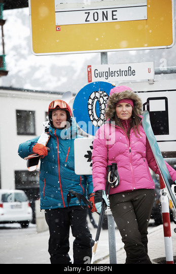 Young people standing beside sign in Obergurgl ski resort - Stock-Bilder