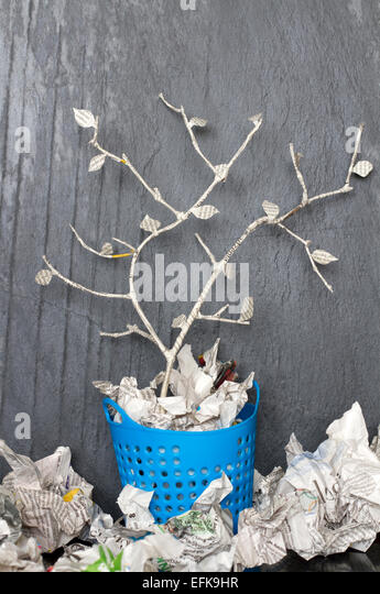 Paper tree in recycle trash can unique abstract concept - Stock Image