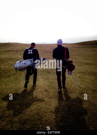 Scotland, Rear view of two golfers - Stock Image