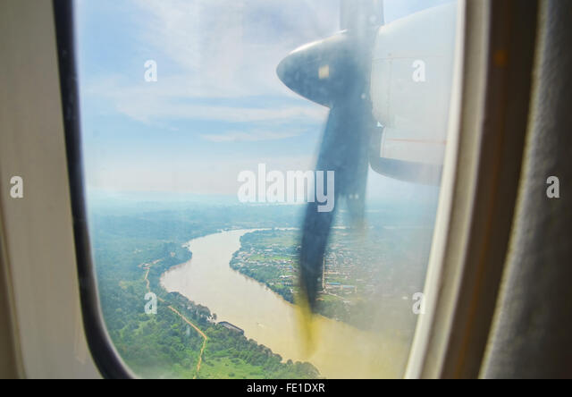 High angle perspective of a river from plane's window - Stock Image