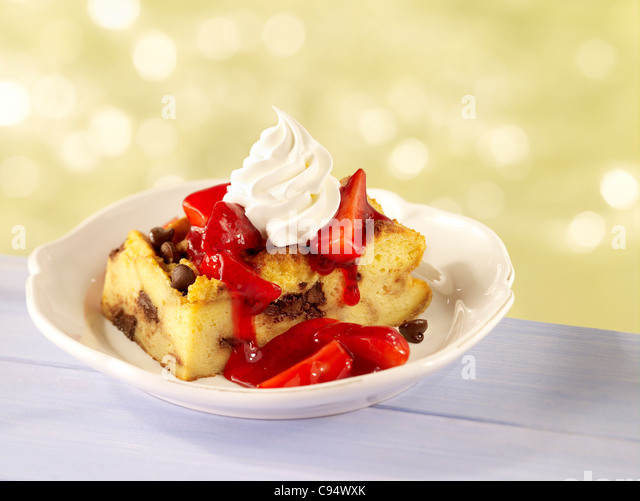 Strawberry bread pudding topped with whipped cream - Stock Image